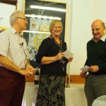 President Nick Pinches presents the winning prize to Victoria Littlewood & Andrew Page