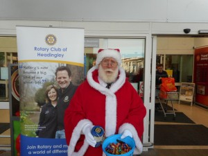 Iain multi-tasks with both collecting and giving sweets to the children
