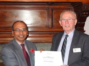 President Pran presents the award to Kevin Grundey